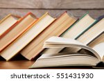 open book on the wooden... | Shutterstock . vector #551431930
