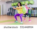two young women doing squat... | Shutterstock . vector #551448904