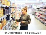 woman shopping in supermarket... | Shutterstock . vector #551451214