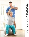 physiotherapist working with... | Shutterstock . vector #551474344