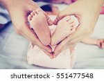 Baby's Feet In Mother's Hand