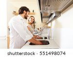 young couple doing dishes in... | Shutterstock . vector #551498074