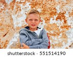 portrait of a young boy with a... | Shutterstock . vector #551514190