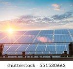 solar panels against a dusk sky ... | Shutterstock . vector #551530663