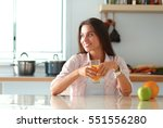 Young Woman Sitting A Table In...