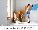 happy young couple moving in... | Shutterstock . vector #551557213