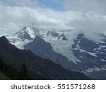 Small photo of Alpine glacier with mountain peak hidden in the clouds