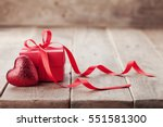 gift or present box with red... | Shutterstock . vector #551581300