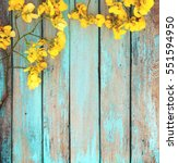 yellow flowers on vintage... | Shutterstock . vector #551594950