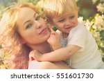 happy woman and child in the... | Shutterstock . vector #551601730