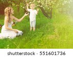 happy woman and child in the... | Shutterstock . vector #551601736