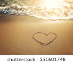 hearts drawn on the sand of a... | Shutterstock . vector #551601748