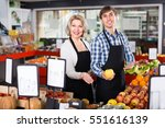 smiling sellers posing with ... | Shutterstock . vector #551616139