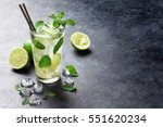 mojito cocktail on dark stone... | Shutterstock . vector #551620234