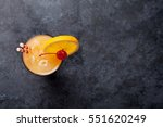 tequila sunrise cocktail on... | Shutterstock . vector #551620249