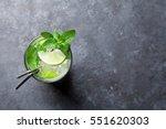 mojito cocktail on dark stone... | Shutterstock . vector #551620303