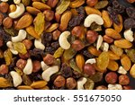 mix of dry nuts and fruits | Shutterstock . vector #551675050