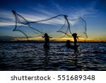 Two Fishermen Throwing Fishing...