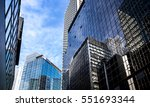 office buildings stretch up to... | Shutterstock . vector #551693344