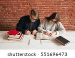 Small photo of Students man and woman recapitulate text top view. Studying in library, preparing for exams. Education, pair project, teamwork, brainstorm concept