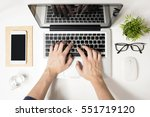man is typing on his laptop.... | Shutterstock . vector #551719120