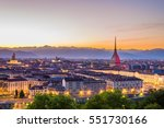 Cityscape of Torino (Turin, Italy) at sunset with colorful clear sky. The Mole Antonelliana towering on the city.