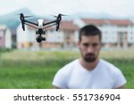 man operating drone flying or... | Shutterstock . vector #551736904