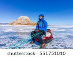 girl with a sledge and trekking ... | Shutterstock . vector #551751010