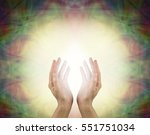 Small photo of Prana Healing Energy Field - Female energy worker with hands outstretched and open upwards sensing white healing energy on pale yellow background with dark vignette edges