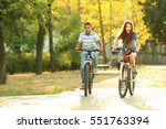 friends riding bicycles in park ... | Shutterstock . vector #551763394
