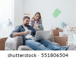 couple relaxing during home... | Shutterstock . vector #551806504