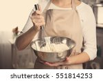 young woman holding bowl with...