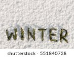 Small photo of Winter word composed of fir branches on the white snow. holiday decorations
