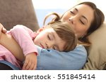 close up of a mother embracing... | Shutterstock . vector #551845414