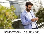 handsome young man with mobile... | Shutterstock . vector #551849734