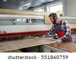 carpenter works on wood plank... | Shutterstock . vector #551860759