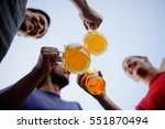 three young men cheerfully... | Shutterstock . vector #551870494