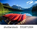 red kayaks at emerald lake in... | Shutterstock . vector #551871304