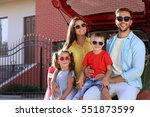 family with kids sitting in car ... | Shutterstock . vector #551873599