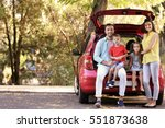 family with kids sitting in car ... | Shutterstock . vector #551873638