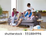 family of four are sitting on... | Shutterstock . vector #551884996
