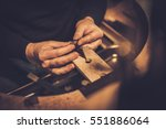 jeweler at work in jewelery... | Shutterstock . vector #551886064