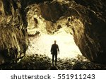 Cave Exploring. Man Silhouette...