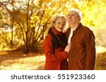 lovely mature couple in autumn... | Shutterstock . vector #551923360