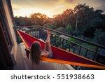 young woman enjoys sunset... | Shutterstock . vector #551938663