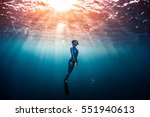 woman free diver ascending from ... | Shutterstock . vector #551940613