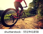 young woman riding mountain... | Shutterstock . vector #551941858