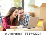 happy couple searching online... | Shutterstock . vector #551942224