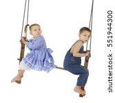 Two Preschool Kids Swinging On...