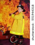 """a young """"fire fighter"""" happily... 